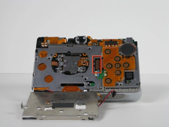 Rotate the camera upside down to locate the small black ZIF connector located in the middle of the camera.