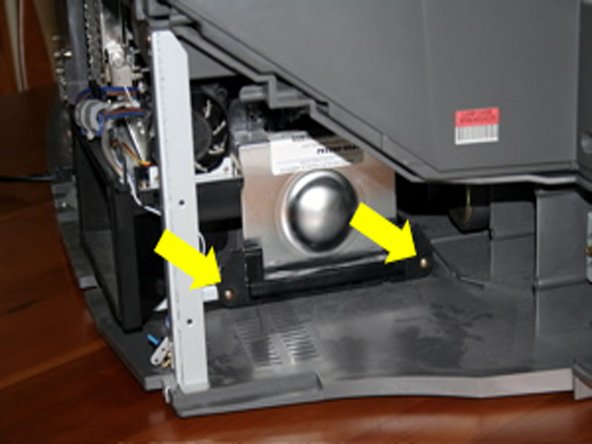 Remove the projector lamp. This may be unnecessary, but (a) it let's you see your target (the color wheel) and (b) it just seems like the safe thing to do. It's easy. Just unscrew the two brass screws holding it in. It's on the right side of the TV. The screws won't come out, just pull them out with the whole unit by pulling on the handle and sliding it straight out. Carefully store it somewhere safe.