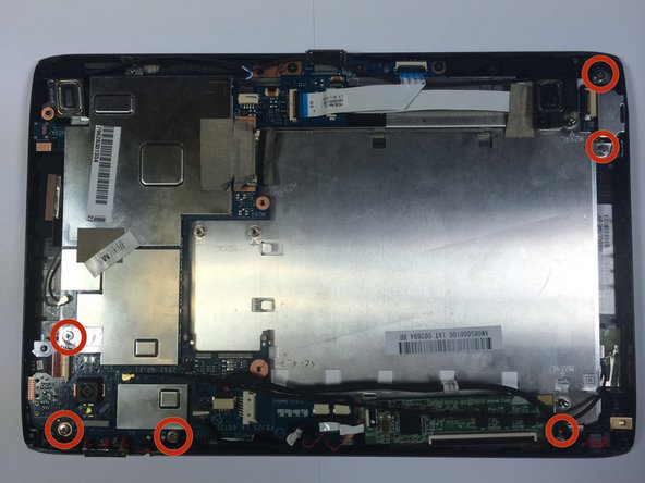 Using the Phillips #1 screwdriver, remove the screws near the edges of the tablet.