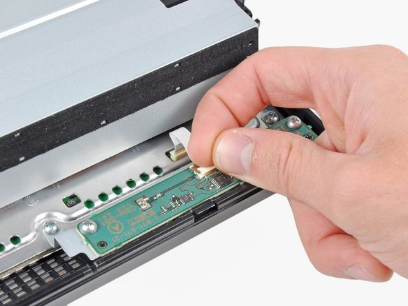 Use your fingernail to flip up the retaining flap on the control board ribbon cable socket.