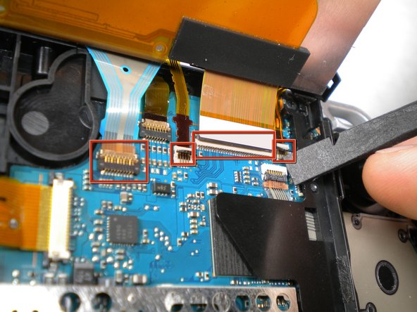 Flip the small brown locks on the four ribbon cable connectors up using a spudger or fingernail.