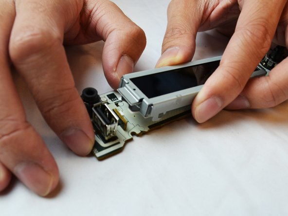 Lift the LCD Screen to remove and replace it.