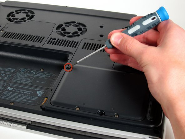 Remove the 8mm Philips screw located between the hard drive and the WiFi card.