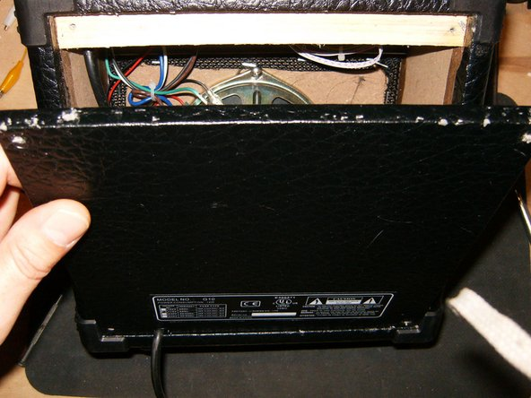 Once the panel is freed from the recess, fold it down and remove from amp.