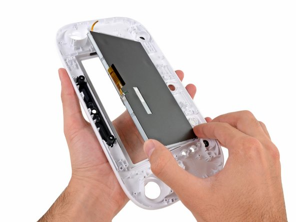 In what can only be hailed as a win for repair enthusiasts, the display assembly lifts off the GamePad's front case without any resistance from adhesive.