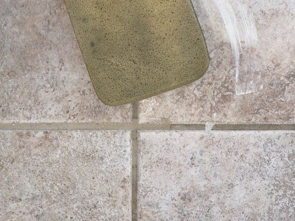 Take the grouting sponge and smooth out the grout evenly.