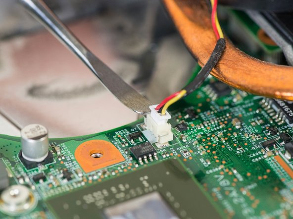 Use your fingers or a spudger to remove the power pin connecting the fan to the laptop by pulling it straight up off the motherboard.