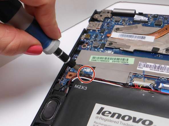 To remove the battery, use a Phillips head screwdriver to unscrew three 3.175 mm screws. One will be in the center of the battery (covered by a Lenovo sticker) and the other two are in the corners.