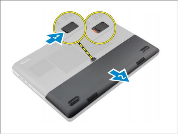 Slide the release latch to unlock the battery cover.