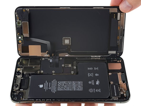 Time to get our first glimpse inside this Professional Maximum iPhone complete with monstrous L-shaped battery—with two battery connectors? Now that's new.