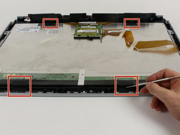 Set the computer aside, and use a small knife to cut the strips attaching the display to the digitizer.