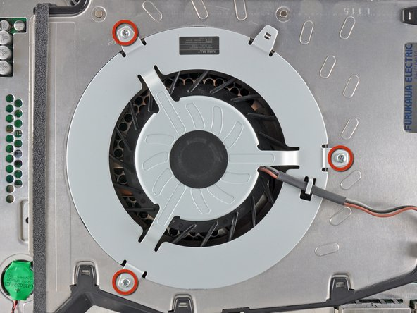 Remove the three 5.7 mm #0 Phillips screws securing the fan to the heat sink.