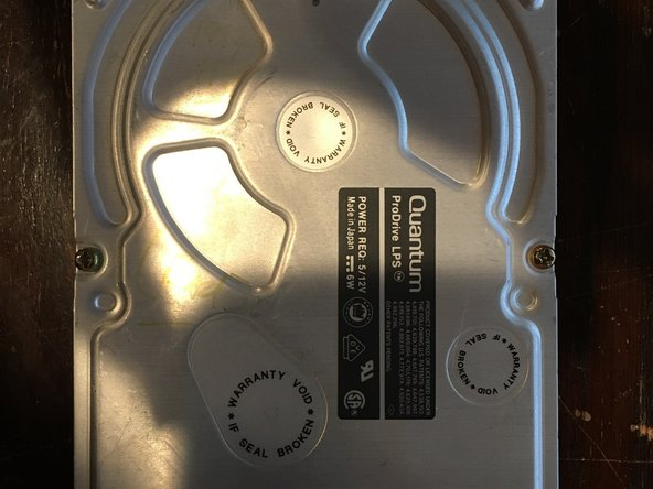 The first picture is of the top cover of the drive, and the second picture is of the PCB on the bottom side of the drive (which got cropped - I had to cut out a bit of the board. Sorry!)