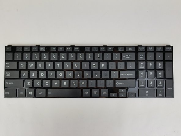 Open up the display and locate the faulty key on the keyboard