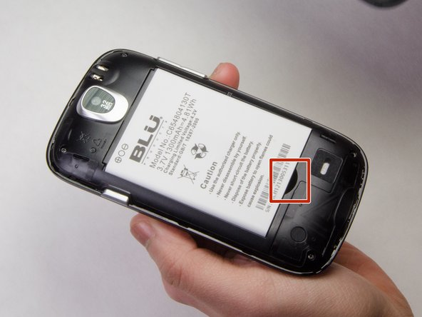 Locate the indentation at the bottom of the battery.