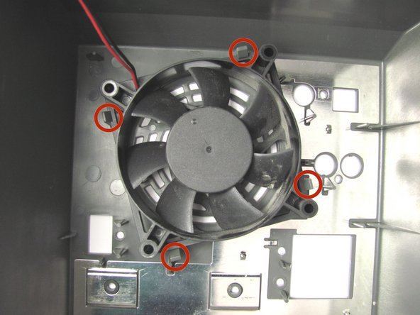 Flip the back panel over and locate the four clasps holding the fan in place.