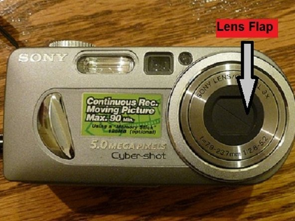Pull back the lens shutters manually if necessary.