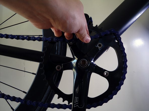 With the slack previously made, remove the chain off the chainring.