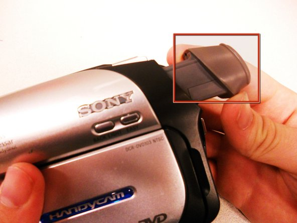 Extend the gray viewfinder so the black, plastic casing will have room to come off.