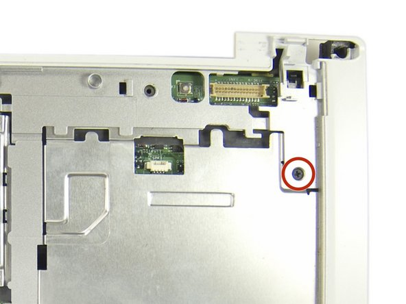 Remove one Phillips screw near the top-right of the keyboard area.