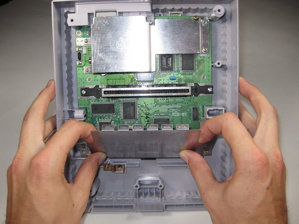 Lift the front shield straight up to remove it from the motherboard.