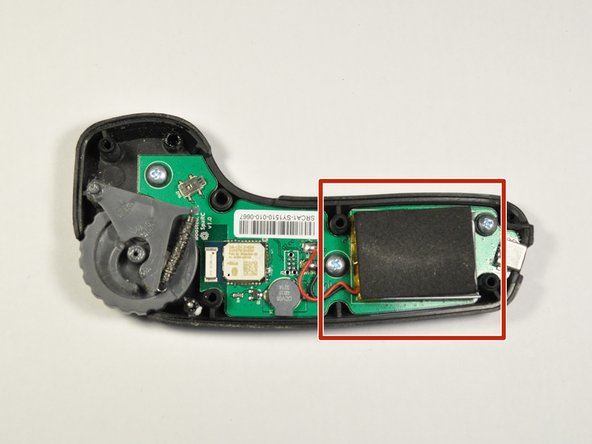 Remove the rectangular black adhesive foam on top of the battery by peeling it away from the battery.