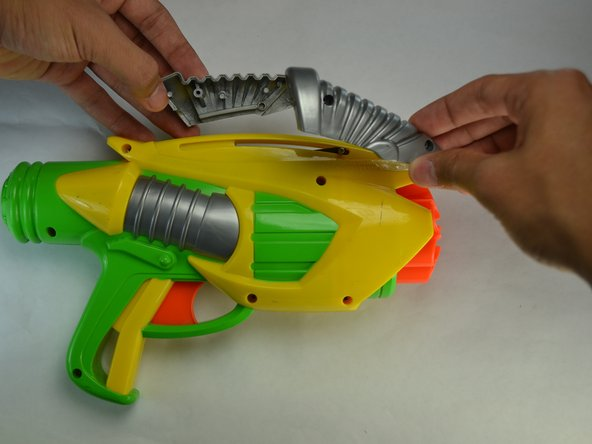 Remove grey slider from the main body of the blaster.