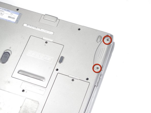 Remove the two 5.8mm screws securing the hard drive bay.