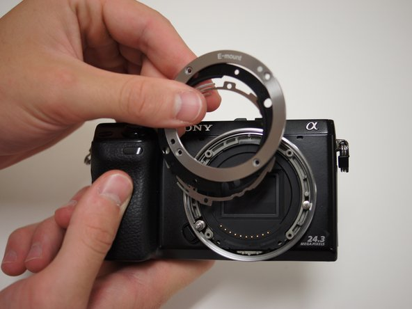 Remove these three layers from the lens mount with your finger or by turning the camera face down.