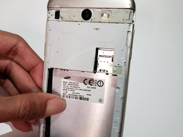Turn the device over, and push firmly to separate the metal plate from the back paneling.