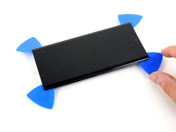 Slide the opening pick from the top right corner down towards the bottom right corner of the phone to slice the adhesive.
