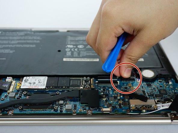 Disconnect the battery from the motherboard by gently pulling up and down on the connector.