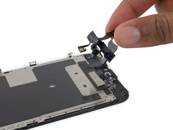 Remove the front-facing camera and sensor cable.
