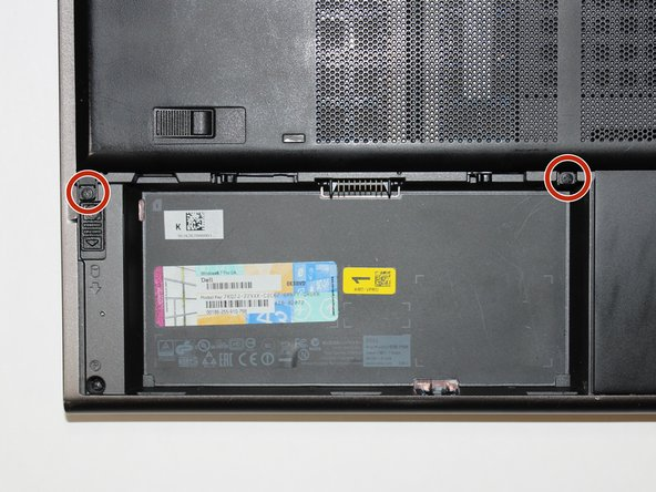 Using a Phillips #1 screwdriver, remove the two 5 mm screws fastening the backplate.