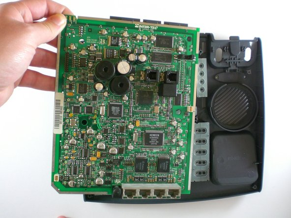 Lift up the motherboard and set aside