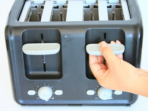 Firmly grip your hand around the slot lever.