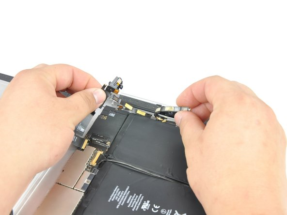 Carefully peel the front camera cable off the bottom ribbon cable attached to the headphone jack.