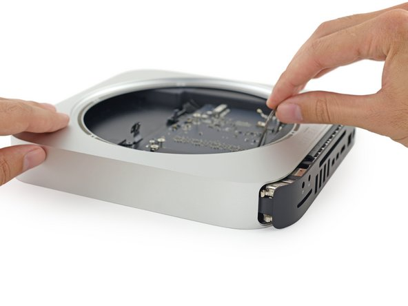 Using our handy hand-powered Mac mini logic board removal tool, we handily remove our Mac mini's handsome logic board.