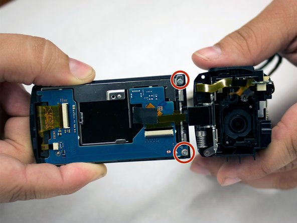 Remove the two silver-colored 4.5 mm Phillips #00 screws from LCD board.