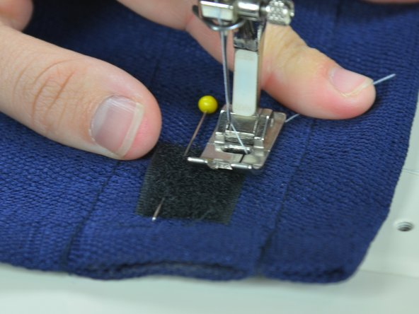 Position your fabric under the presser foot of your sewing machine in the upper right hand corner of the hook-and-loop tape. Drop the presser foot.