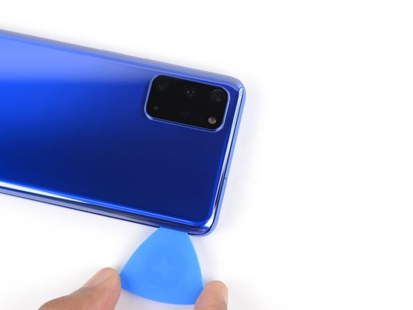 The glass near the corners of the back cover is curved and very susceptible to cracking. Be gentle during this step to prevent damaging your back cover.