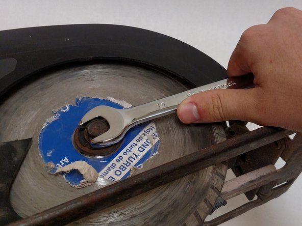 Use the crescent wrench to remove the hex washer head screw and the washer.