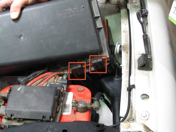 Lift the air filter cover up, starting from the back end, making sure to release them from the hinges on the front end.