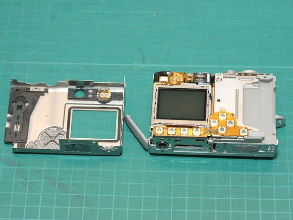 You can now remove both the front and rear shells of the camera body