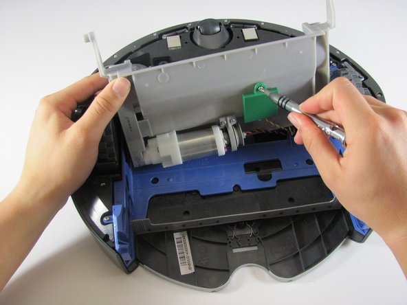 Use a Phillips #0 to remove the two  6 mm  screws securing the green circuit board protector.
