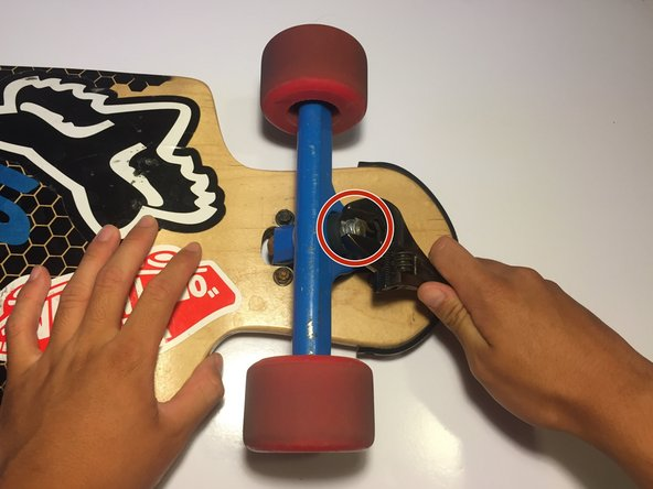 Start by placing your board on its top so that you can access the trucks.