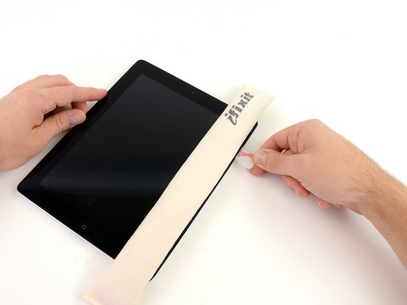Remove the plastic opening tool from the iPad, and push the opening pick further underneath the front glass to a depth of ~0.5 inches.