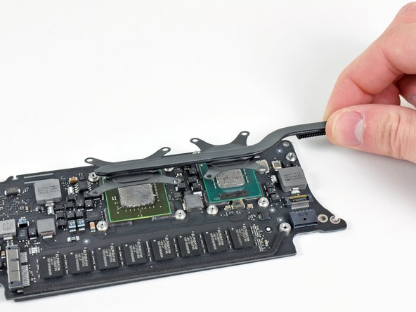 If the heat sink seems to be stuck to the logic board after removing all eight screws, use a spudger to carefully separate the heat sink from the faces of the CPU and GPU.