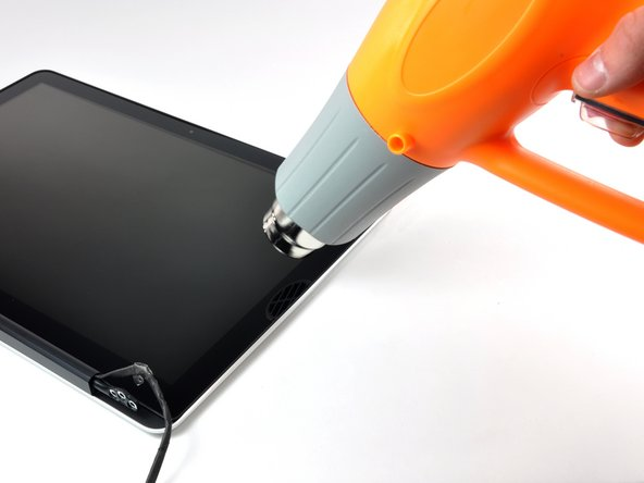 Use a heat gun to soften the adhesive under the black strip along the right side of the front glass panel.