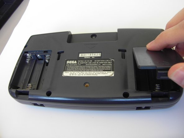 Press on the tabs at the bottom of the battery covers then lift up to remove.